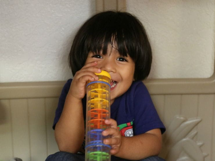 A child plays with a toy at the Bright Space at the Humanitarian Respite Center in McAllen, Texas