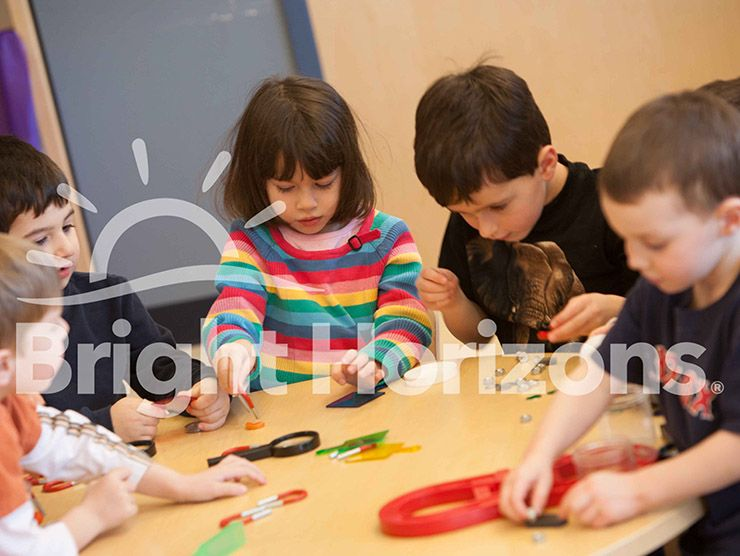 Group of preschoolers doing a magnet activity