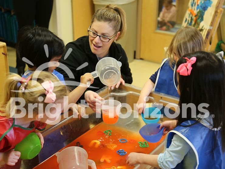 Preschool teacher and students in Bright Horizons classroom