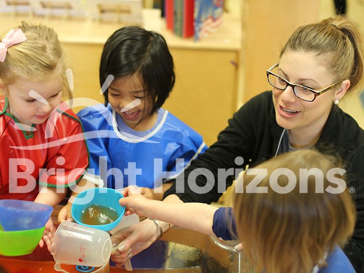 Teacher and Bright Horizons K Prep students doing a STEM activity with water
