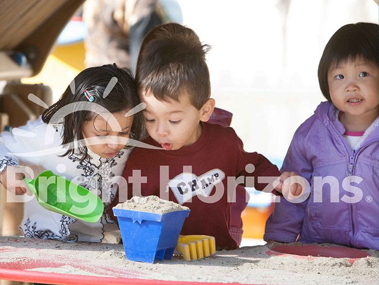 Children playing with sand at Bright Horizons