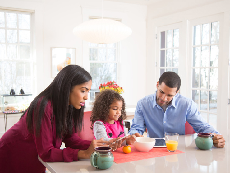 Family with child at breakfast table
