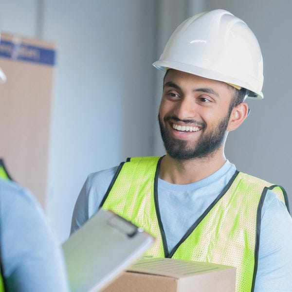 A working man smiling