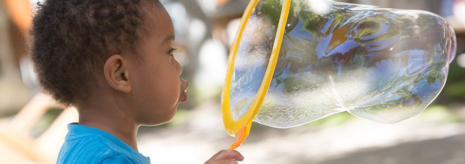 A child blowing a big bubble