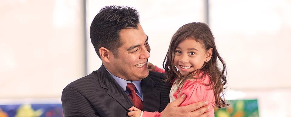 A Happy Father and Daughter at a Bright Horizons Child Care Center